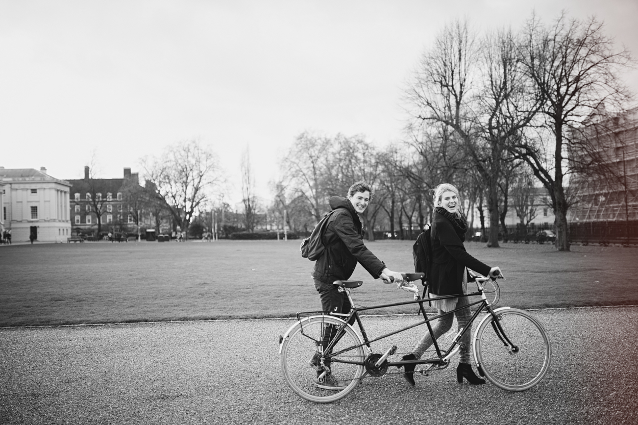 Couple riding on tandem bike in greenwich park by london wedding photographer