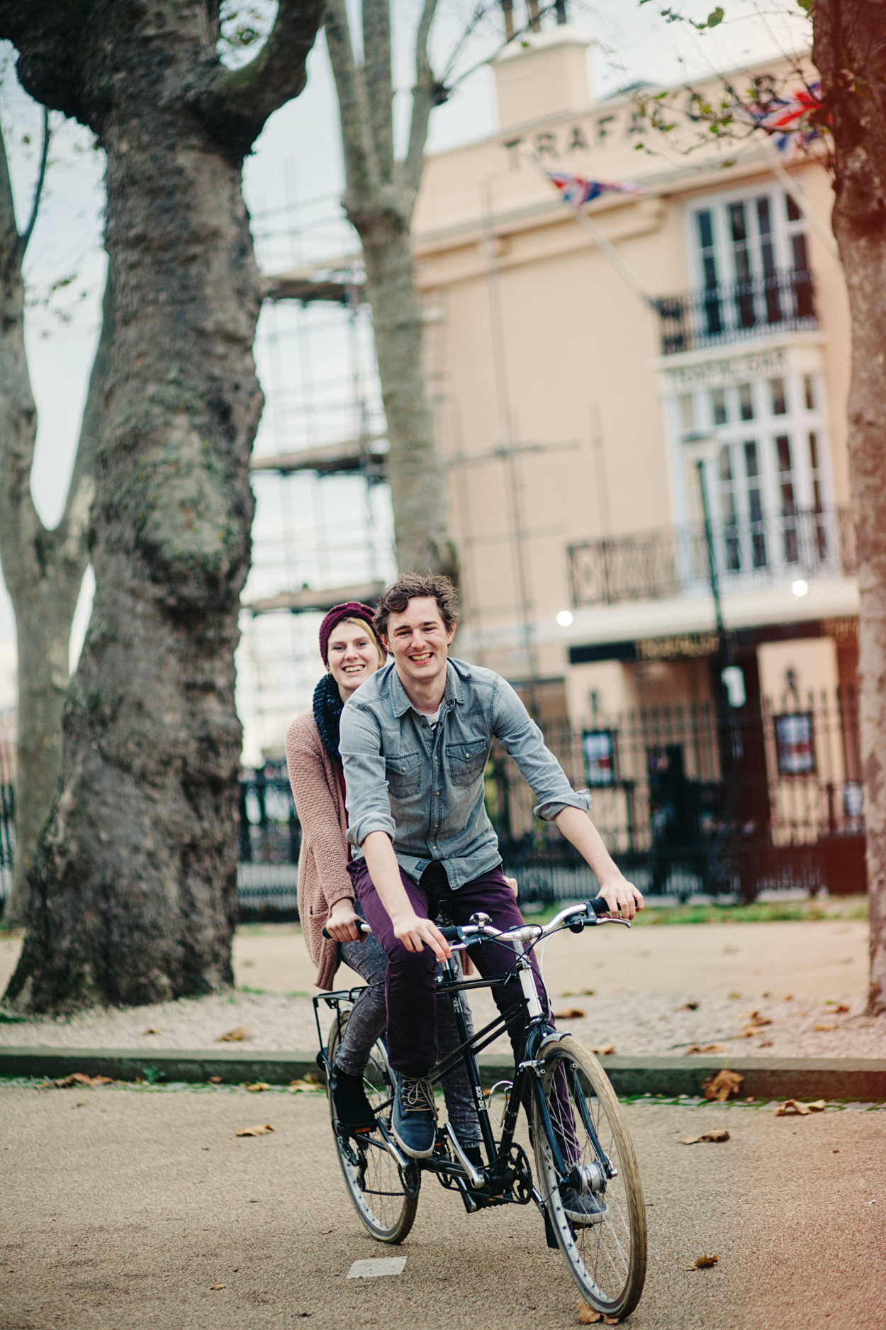 Couple on a tandem bike in Greenwich by London wedding photographer