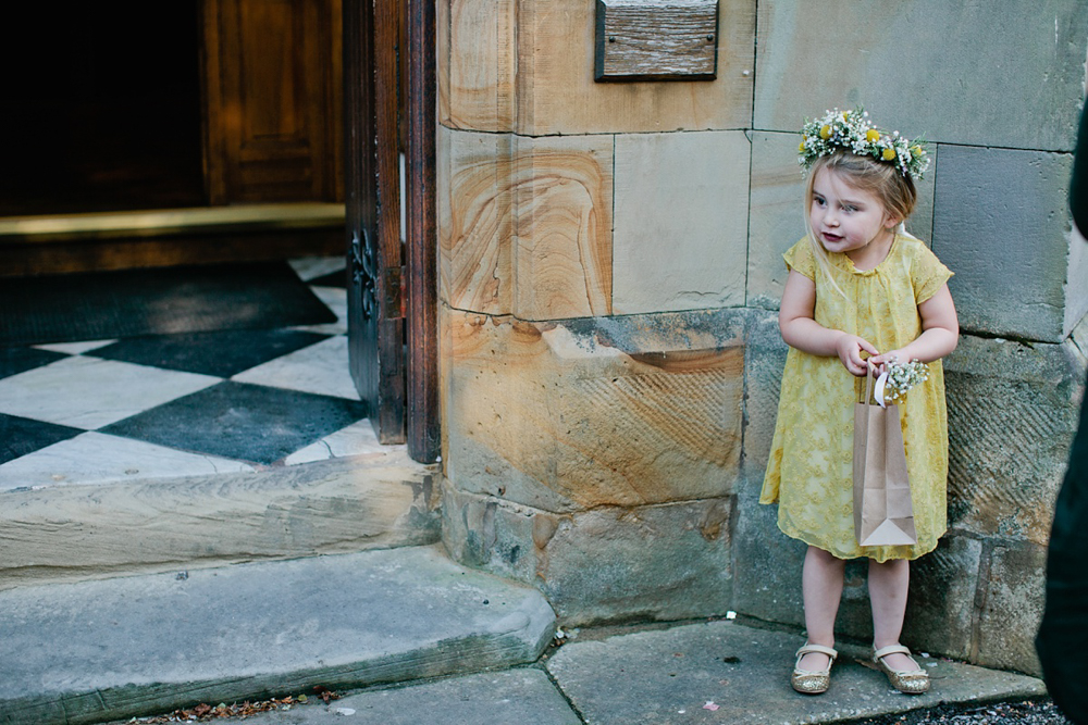 flower girl getting ready with confetti by Hwarden wedding photographer