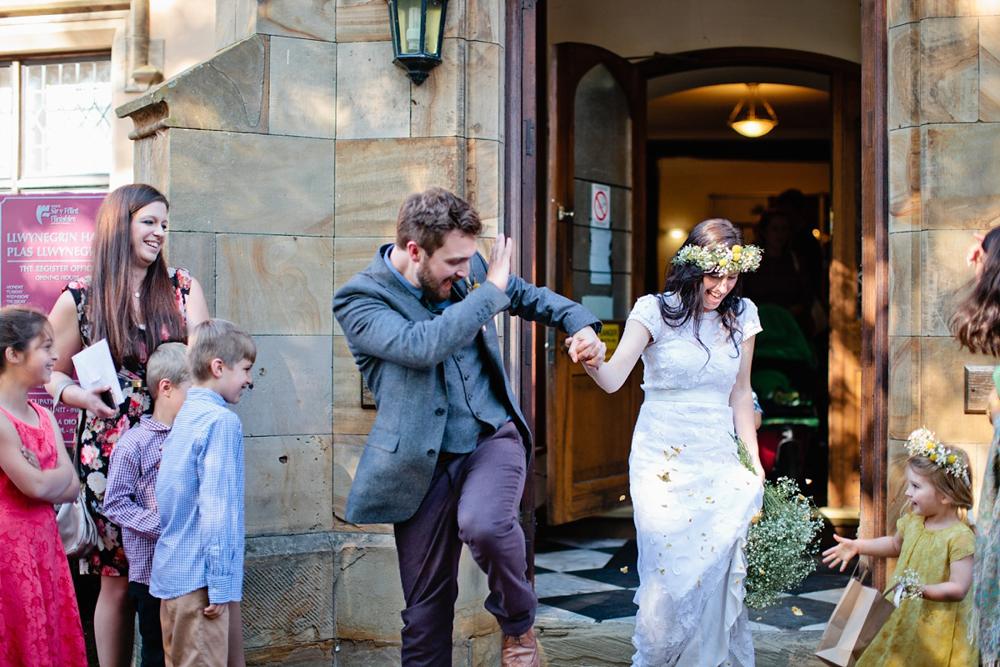 bride and groom and confetti in Hawarden