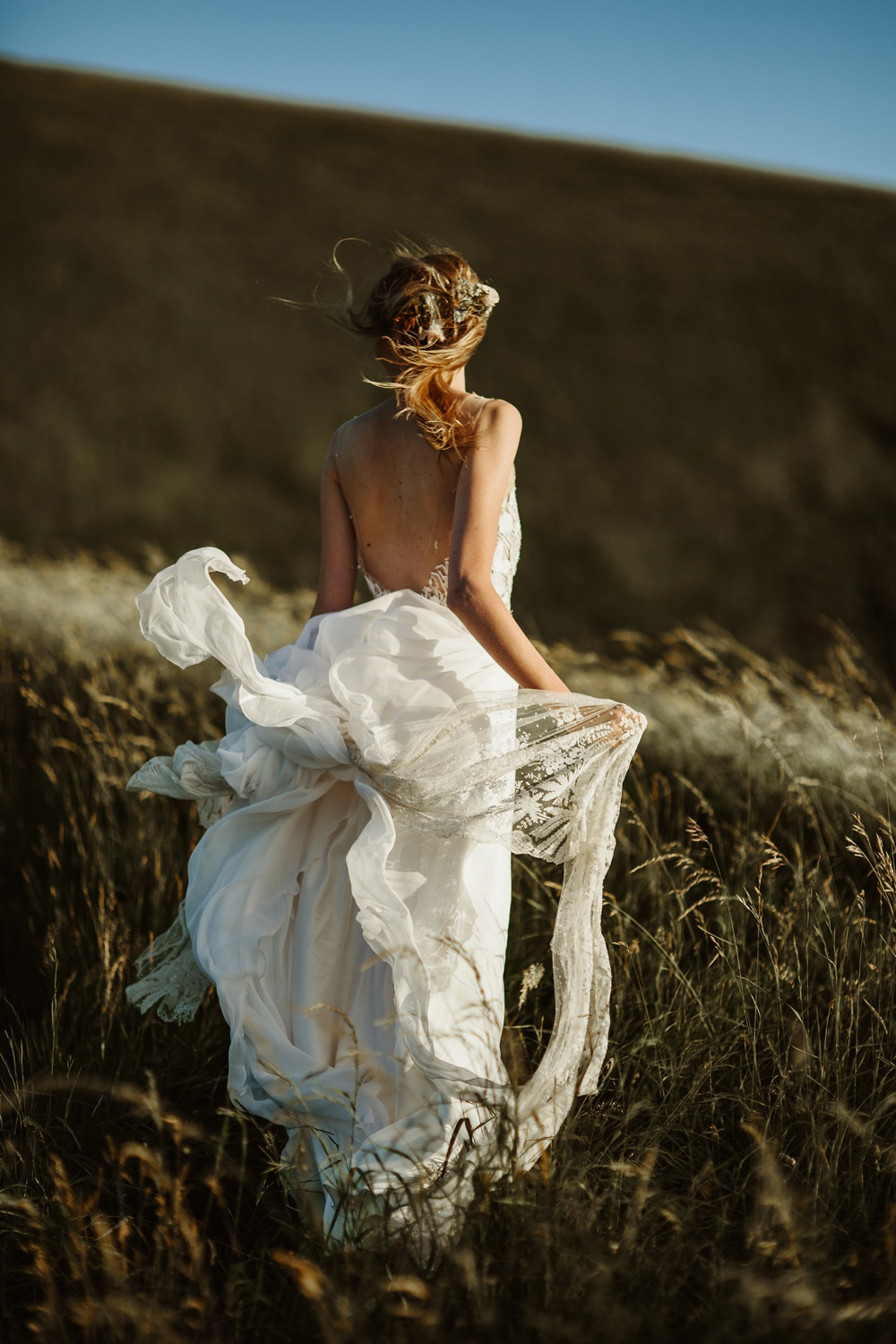 bride portrait in the wind at sunset