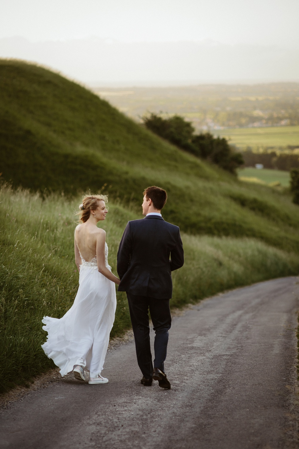 couple holding hands in oxfordshire