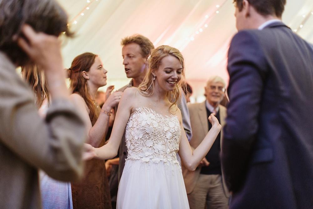 bride dancing at marquee wedding