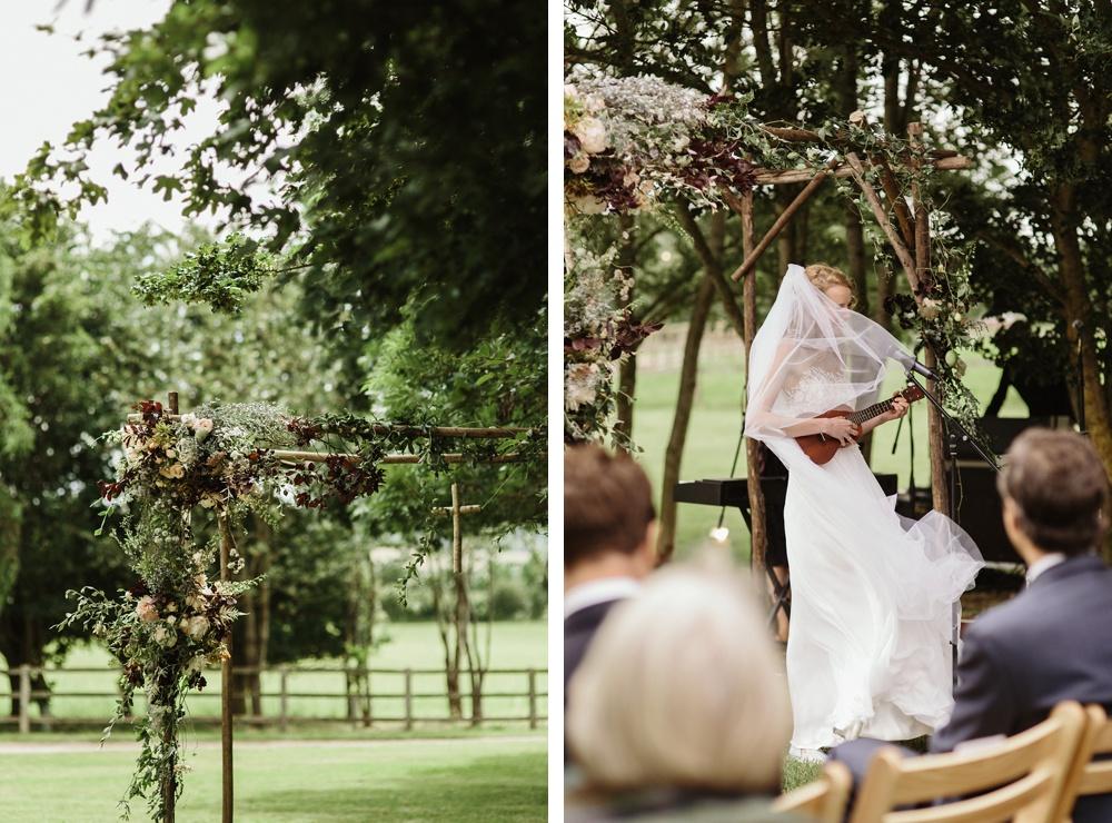 bride playing mandolin for outdoor wedding ceremony