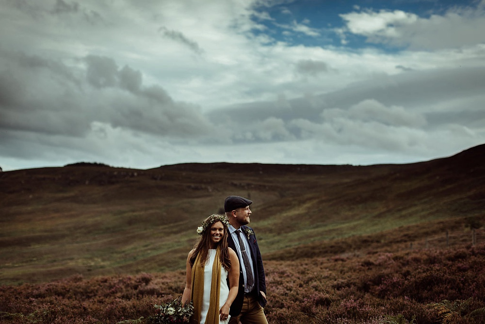 bride and groom on the fields in northumberland