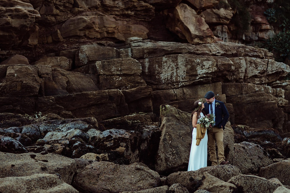 bride and groom portraits on the rocks for their first look portrait session