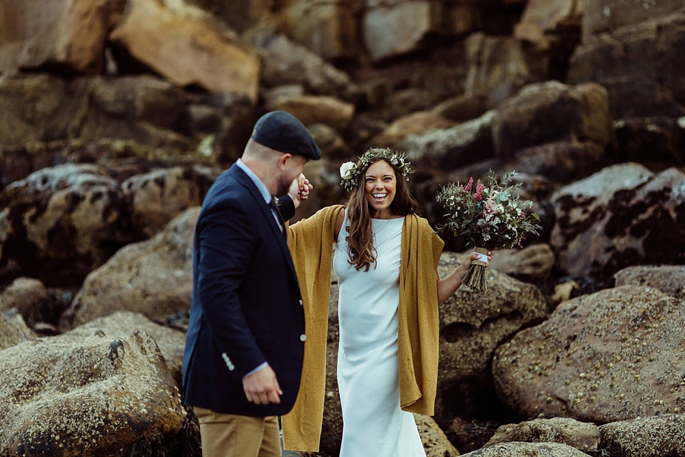 bride and groom during portrait shoot on the beach in North England