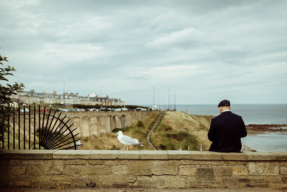 groom writing final parts of vows in Tynemouth