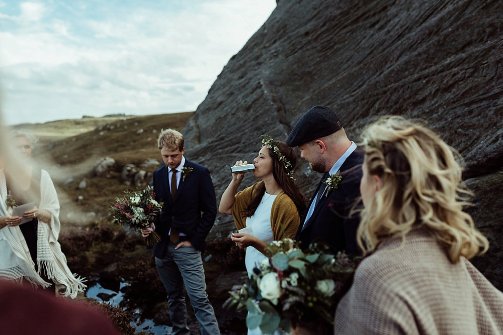 bride drinking whiskey during elopement in Northumberland