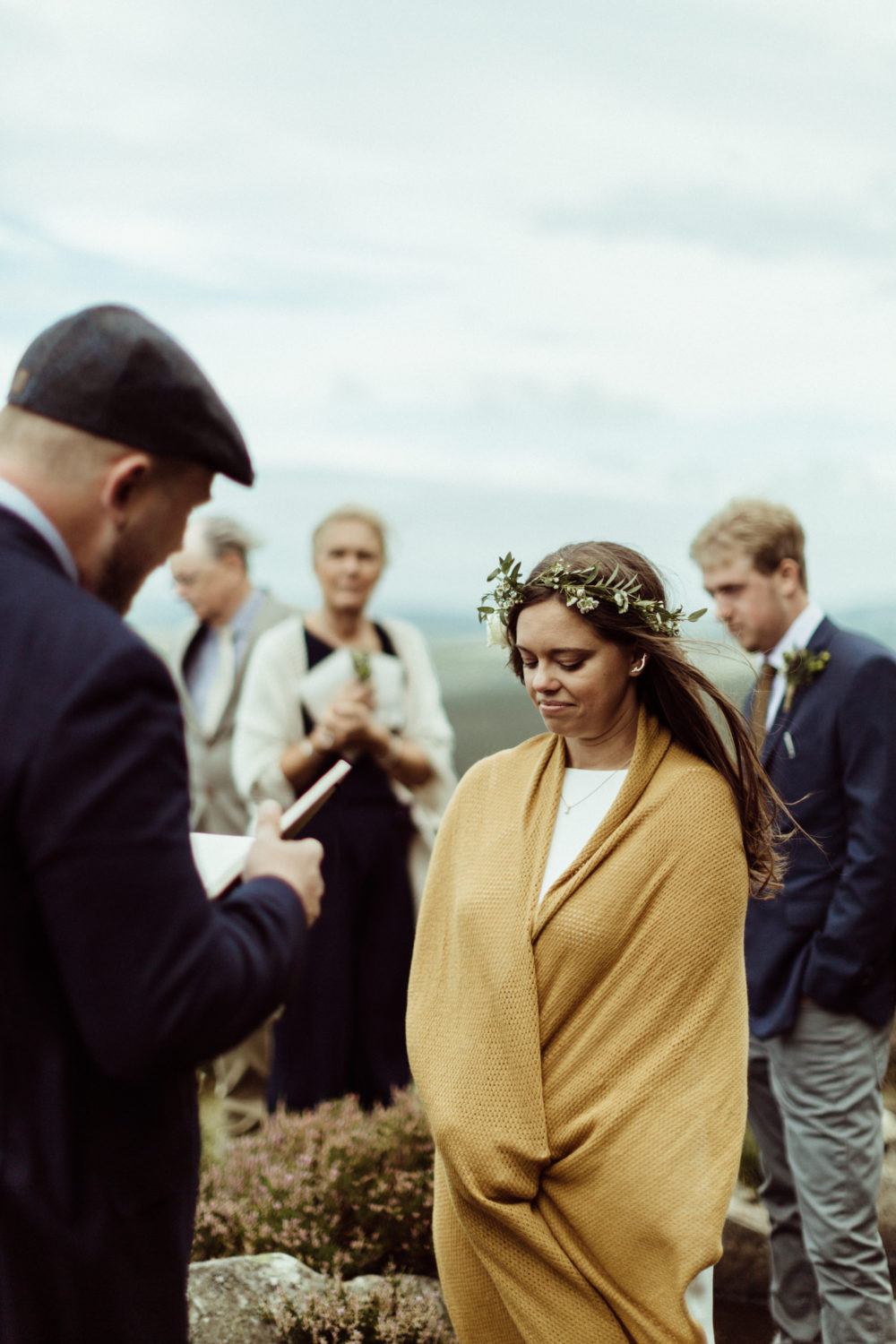 groom reading vows to bride near drake stone in northumberland