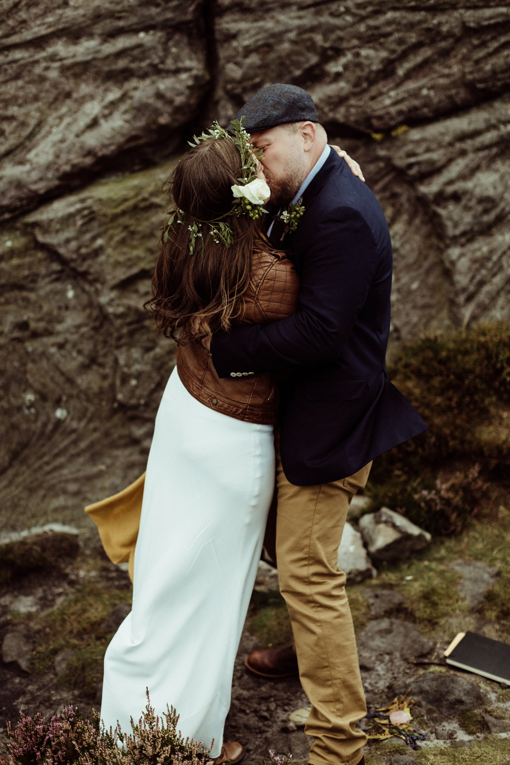 bride and groom first kiss during their elopement at Drake Stone in Northumberland