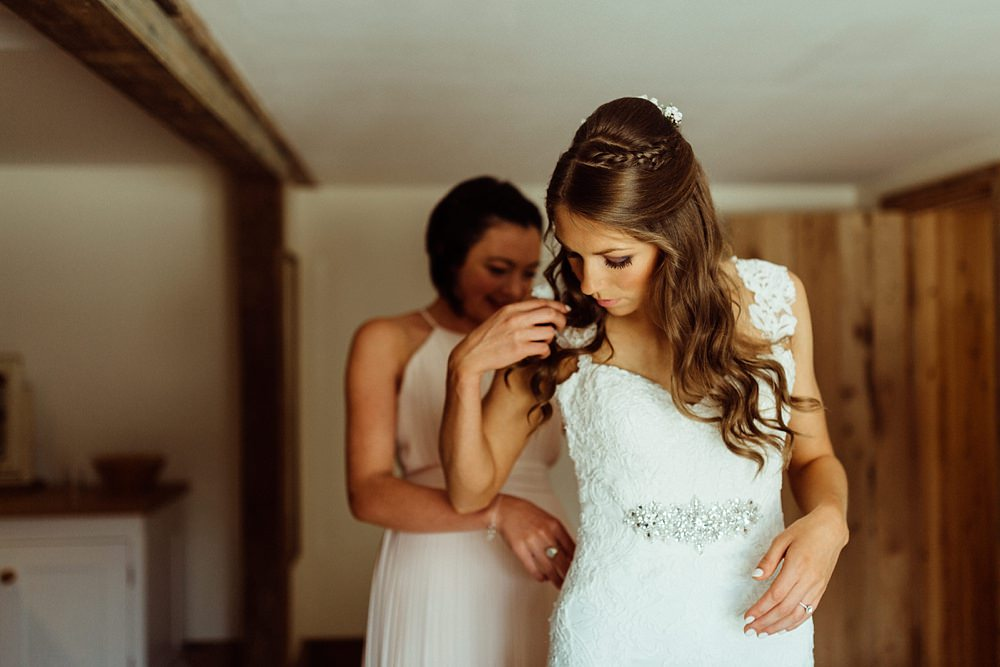 bride getting ready for barn wedding
