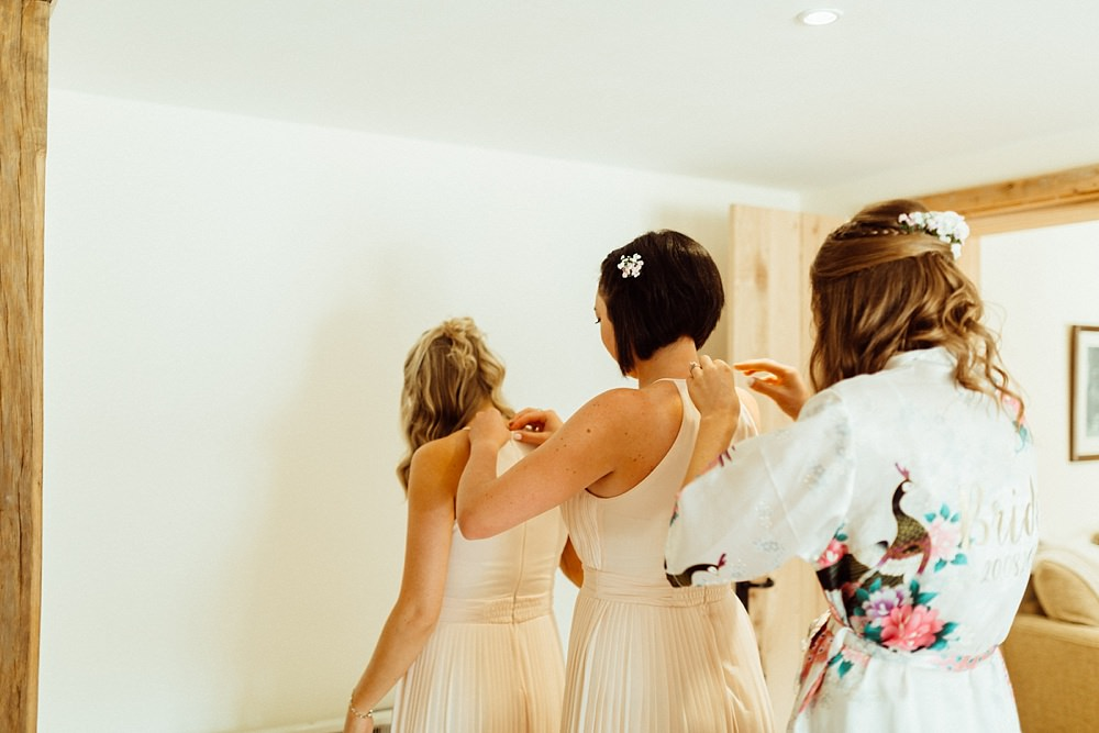 bridesmaids getting ready for Cotswolds barn wedding