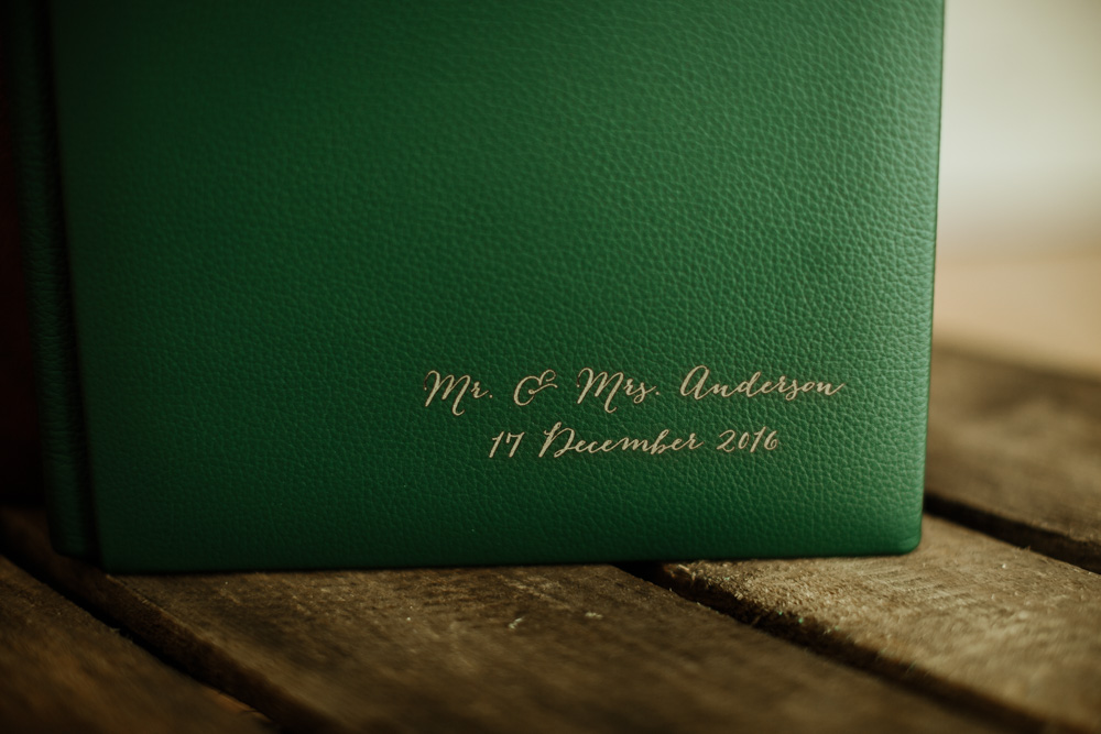 names engraved on leather cover for Wedding photography album