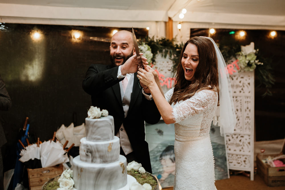 cake cutting during private property marquee wedding