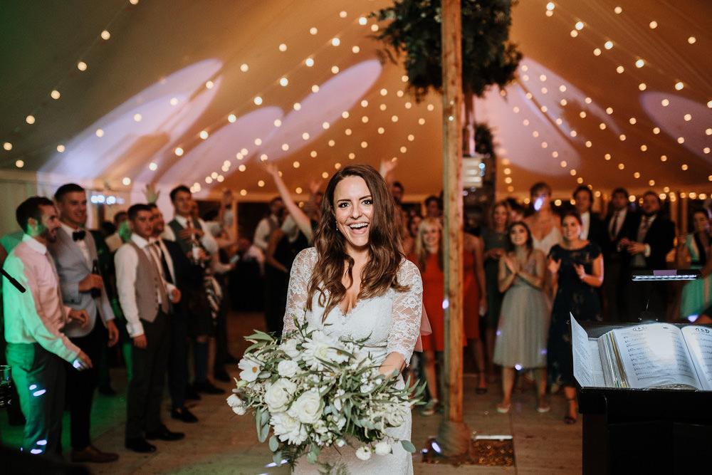 bride throwing bouquet during dorset wedding