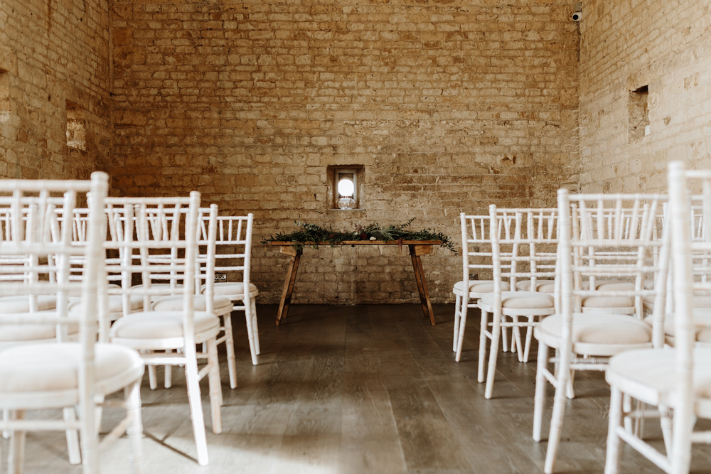 white chairs and wooden table for Lapstone Barn Wedding venue ceremony