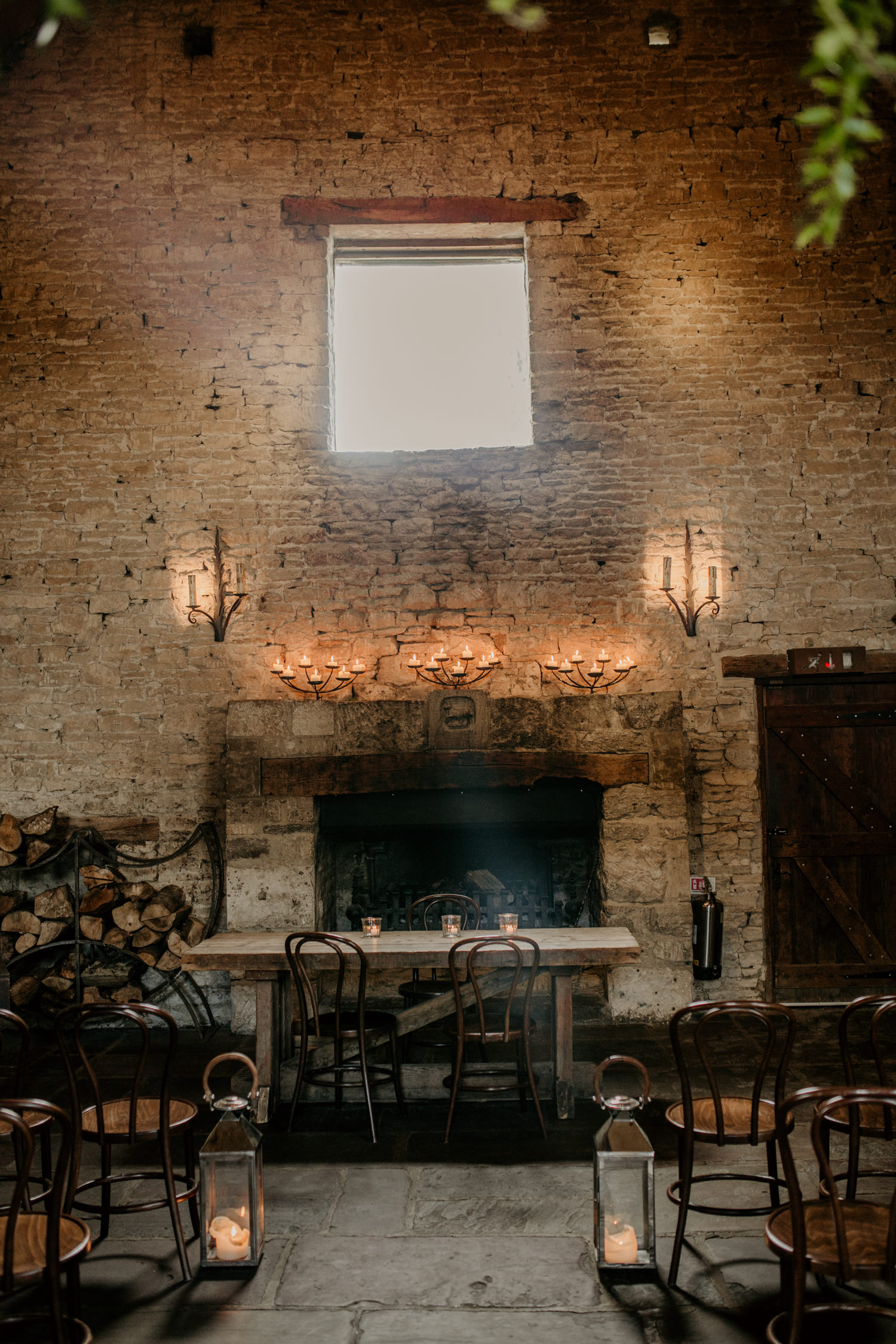 fireplace area at Cripps Barn wedding venue Cotswolds