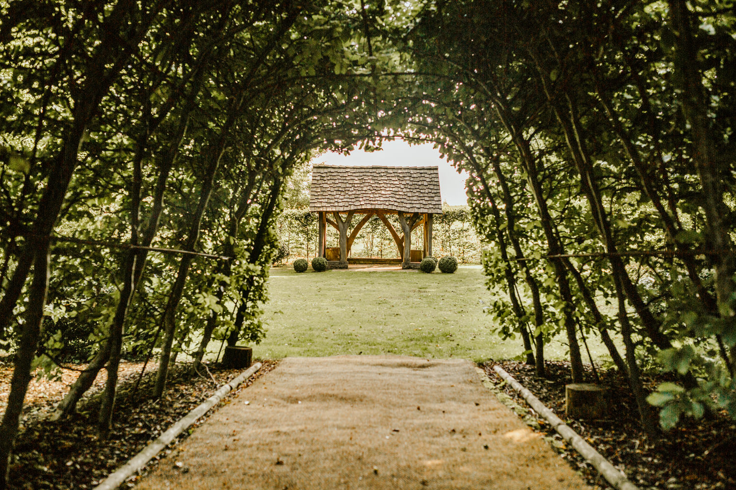 garden area with greenery tunnel at Cripps Barn wedding venue Cotswolds