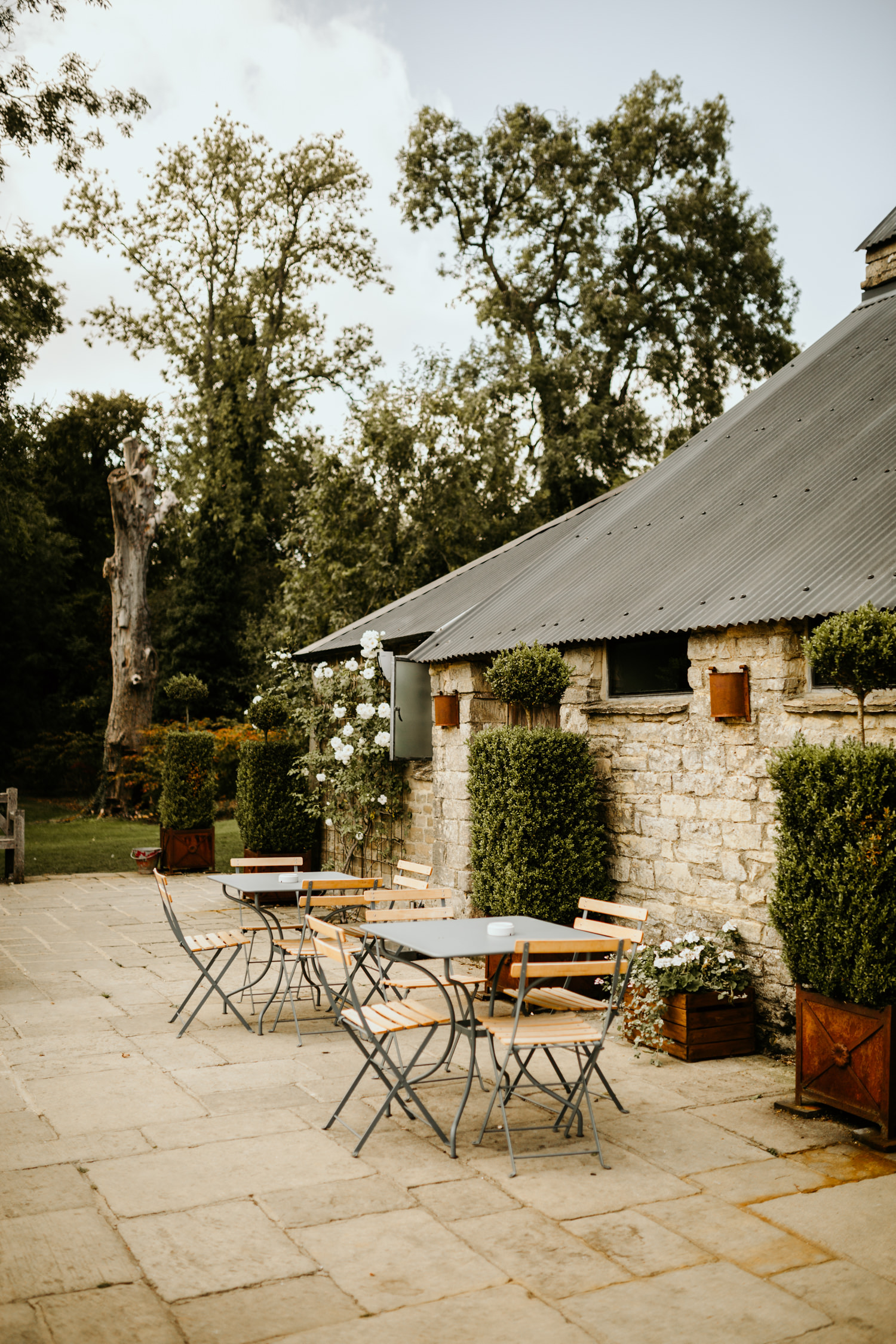 outdoor area with tables and chairs at Cripps Barn Wedding Venue Cotswolds
