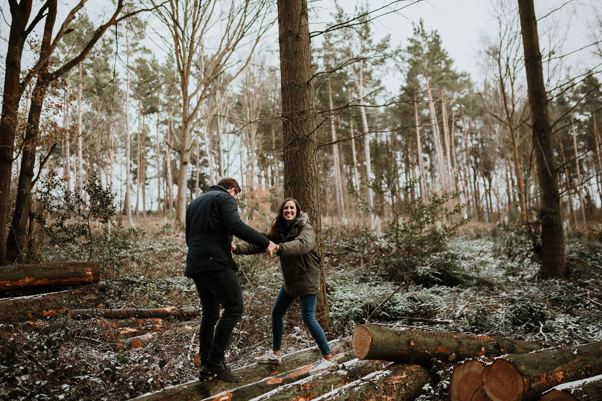 couple walking on logs in Wyre Forest