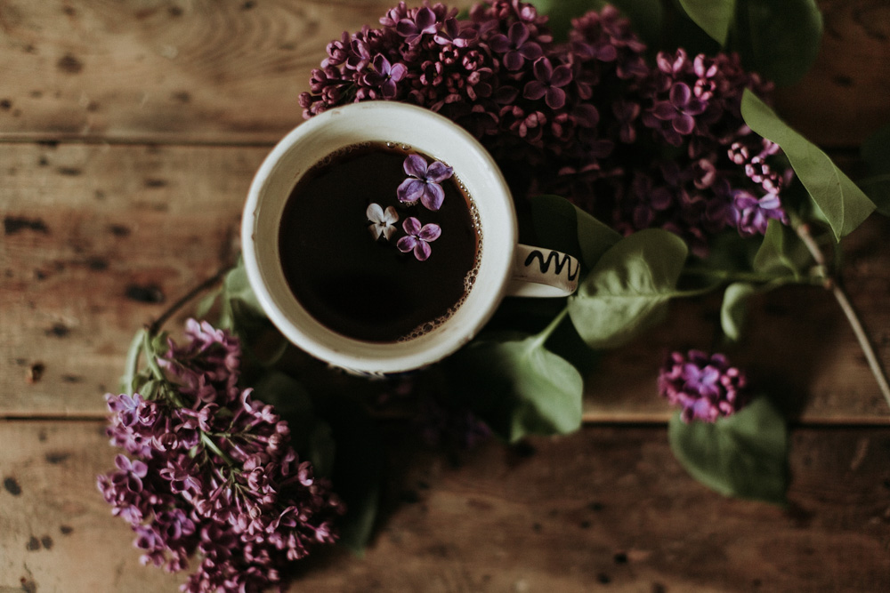 lilac flowers and tea on a wooden table by Cotswolds photographer