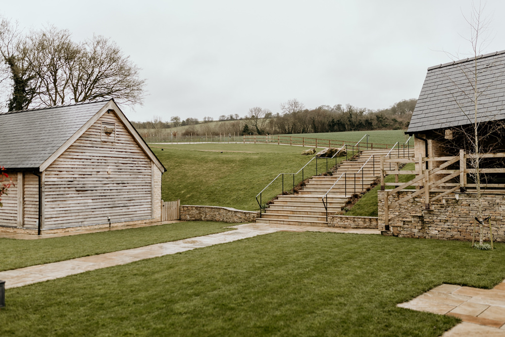 garden area for canapes and entrance to The Barn at Upcote Cotswolds