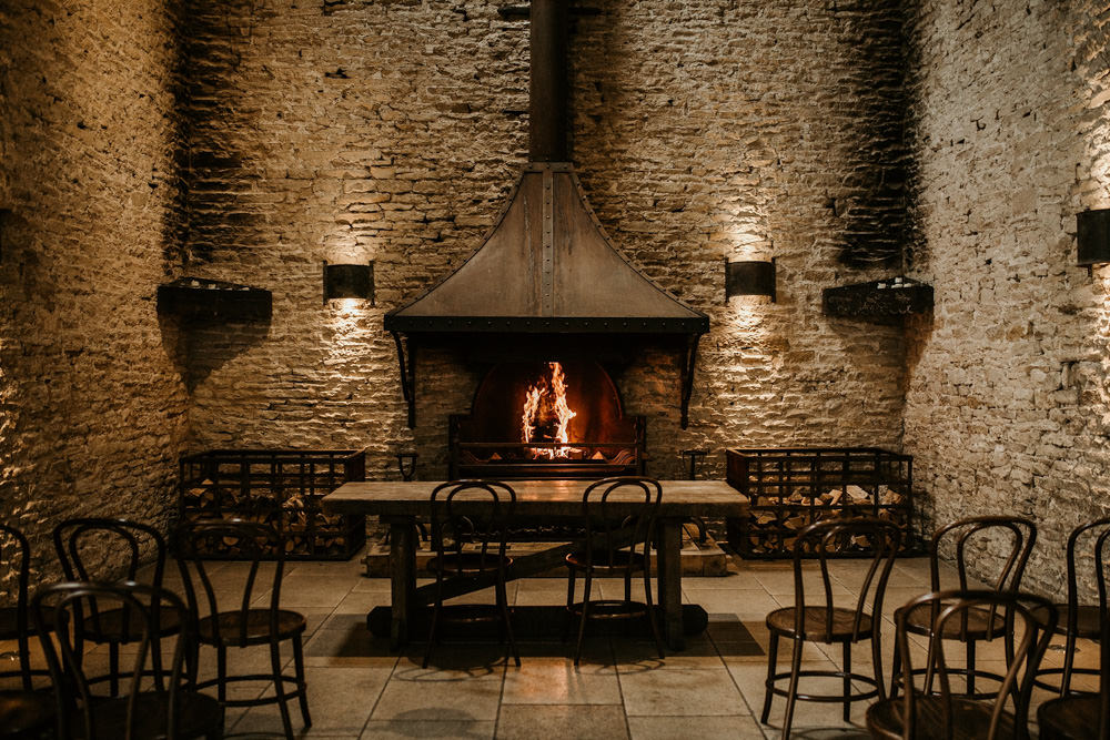 indoor ceremony area by fireplace at Stone Barn in the Cotswolds