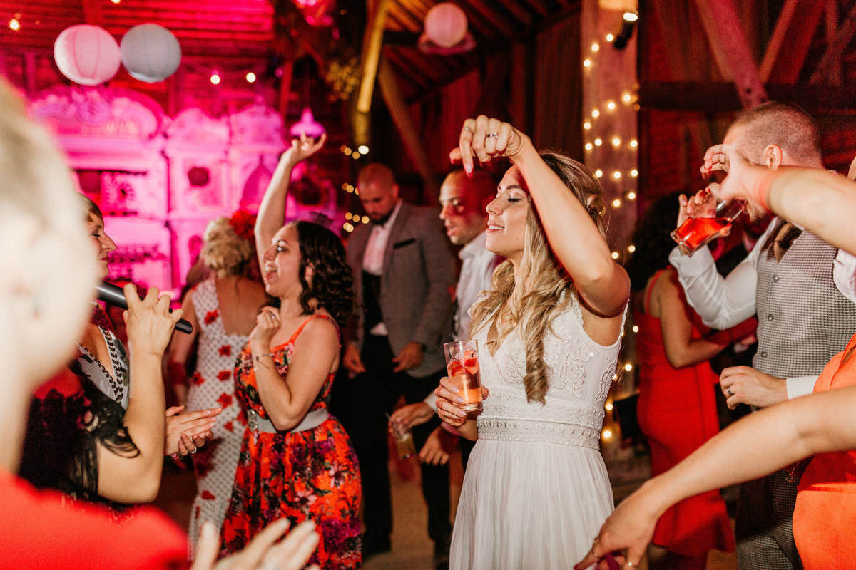 bride having fun during the party at preston court wedding venue by Canterbury wedding photographers