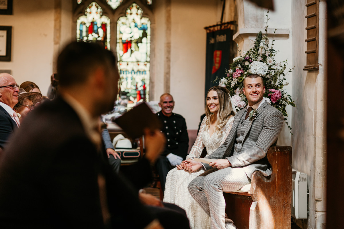 bride and groom during the church wedding ceremony by Canterbury wedding photographers