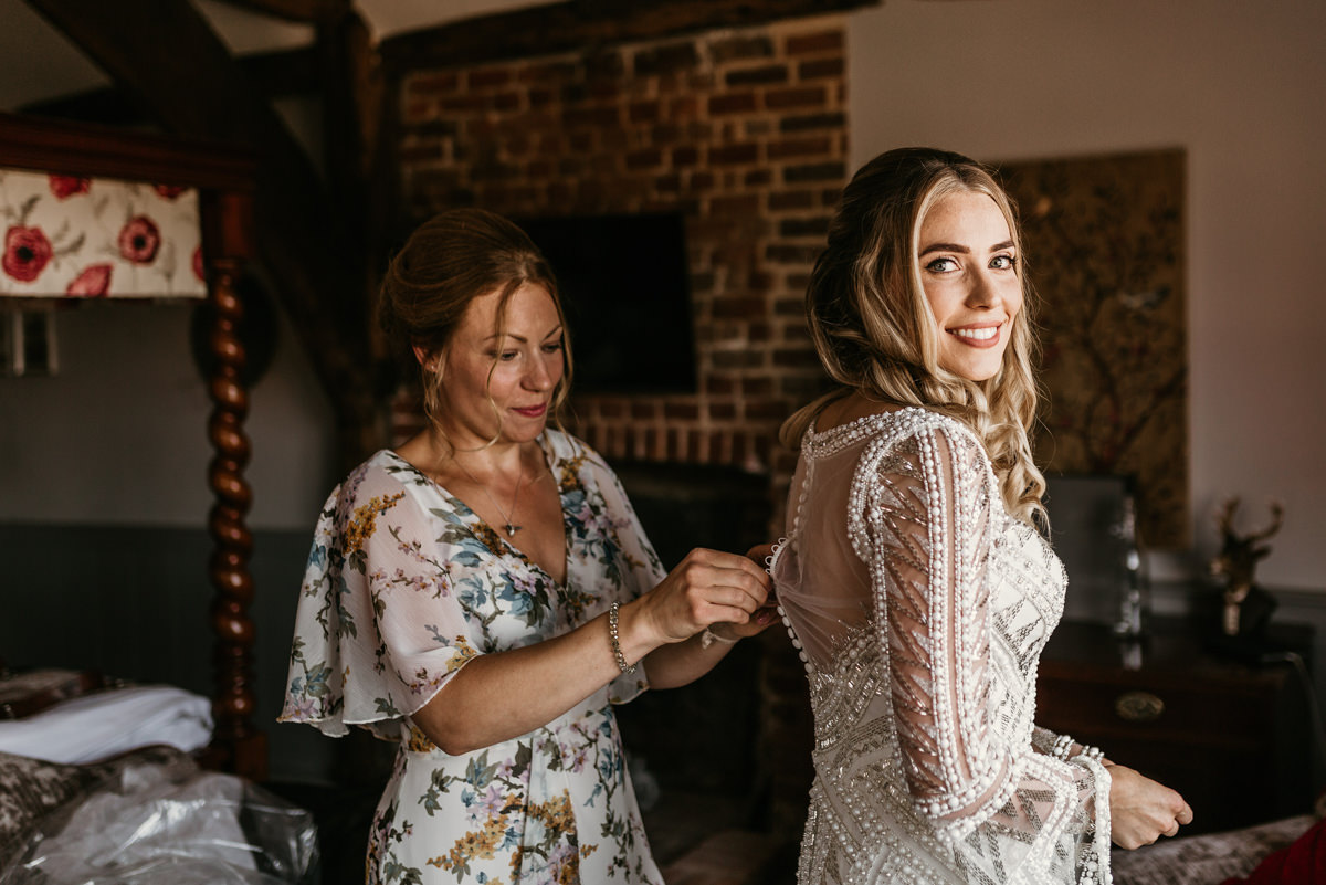 bride getting ready in her Justin Alexander wedding dress by Canterbury wedding photographers