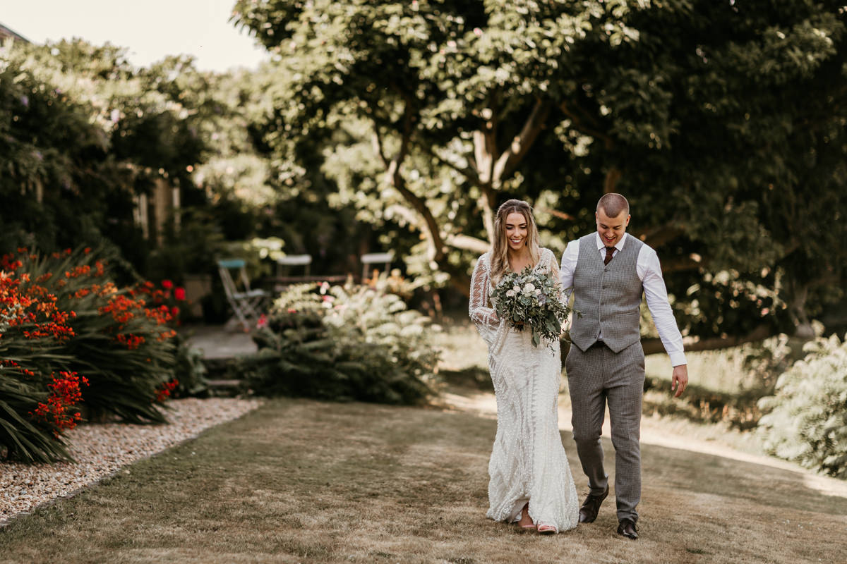 bride wearing a justin alexander wedding dress and groom wearing an asos suit for their wedding at preston court wedding venue by Canterbury wedding photographers