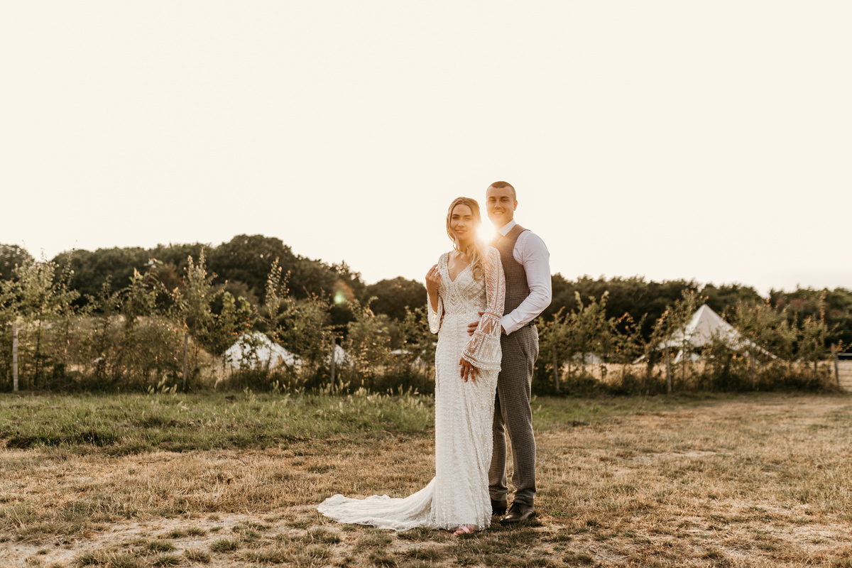bride wearing a justin alexander wedding dress and groom wearing an asos suit for their preston court wedding venue by Canterbury wedding photographers