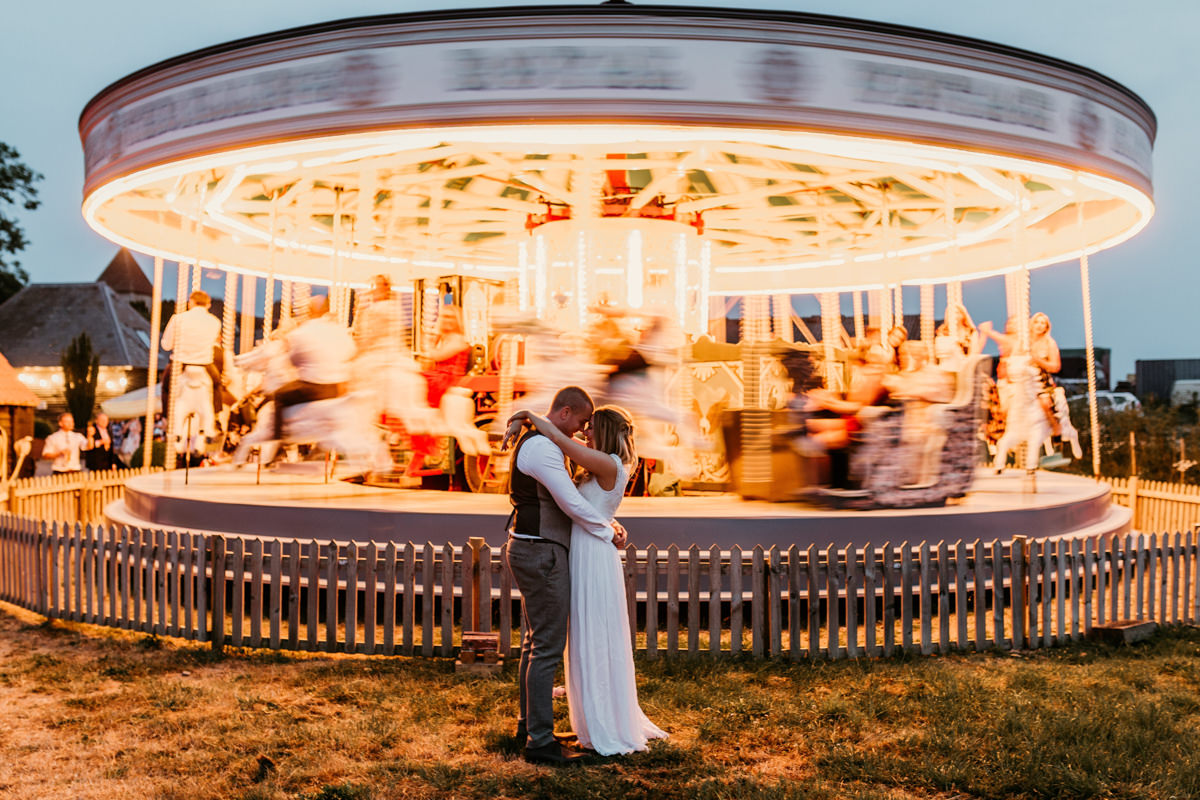 bride and groom portraits in the evening outside the carousel at preston court wedding venue by Canterbury wedding photographers