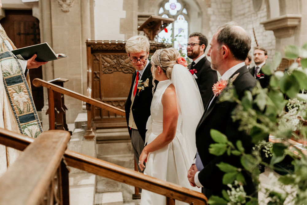 groom getting teary during the wedding ceremony in church Chichester