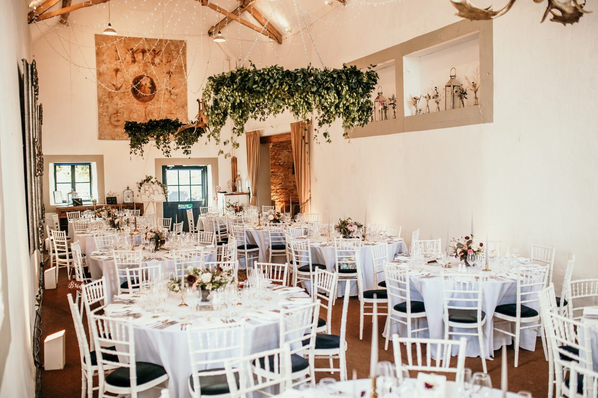 round tables and design inside Merriscourt Barn Wedding venue Cotswolds
