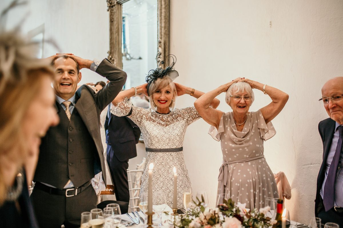 head and tales game idea for wedding during the wedding reception at Merriscourt Barn Wedding venue by Cotswolds wedding photographer