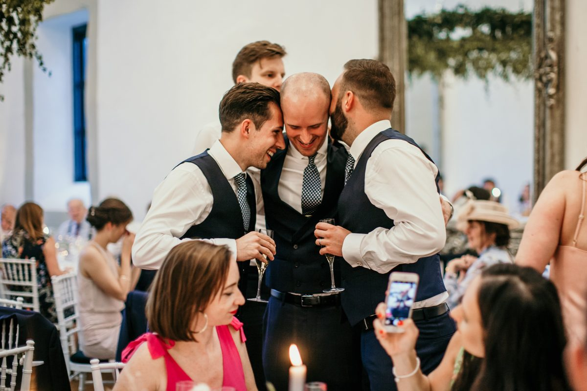 groomsmen after the wedding speeches at Merriscourt Barn Wedding venue by Cotswolds wedding photographer