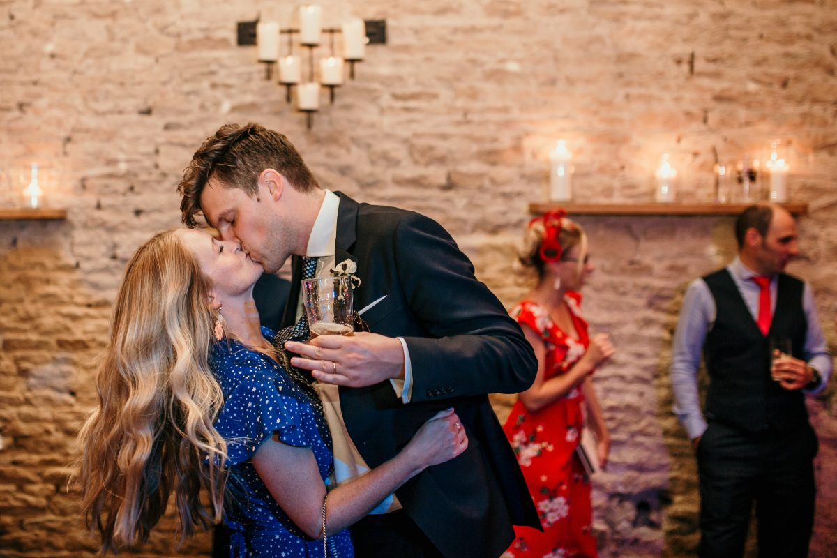 couple kiss on dance floor during the reception party at Merriscourt Barn Wedding venue by Cotswolds wedding photographer