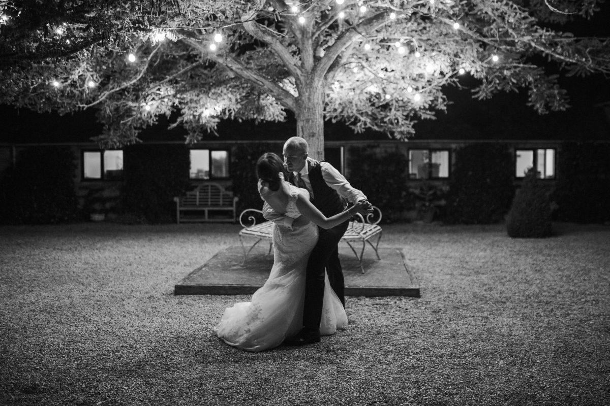 bride and groom dancing in the garden of Merriscourt Barn Wedding venue by Cotswolds wedding photographer