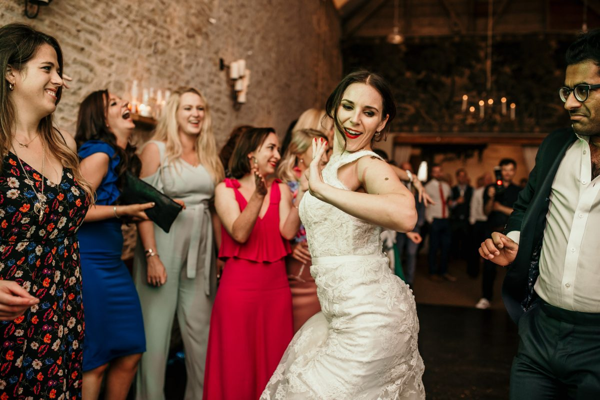 bride dancing at the wedding reception during the party at Merriscourt Barn Wedding venue by Cotswolds wedding photographer