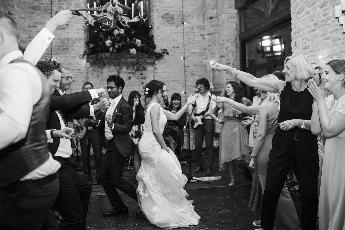 dance off during the wedding party at Merriscourt Barn Wedding venue by Cotswolds wedding photographer