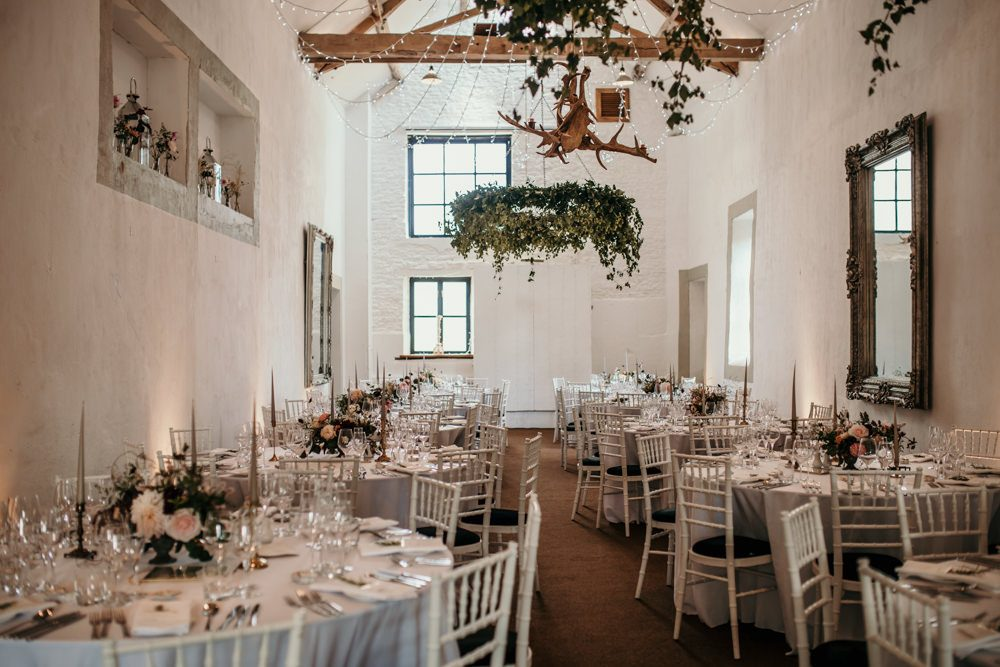 wedding barn decoration with round tables at Merriscourt Barn wedding venue