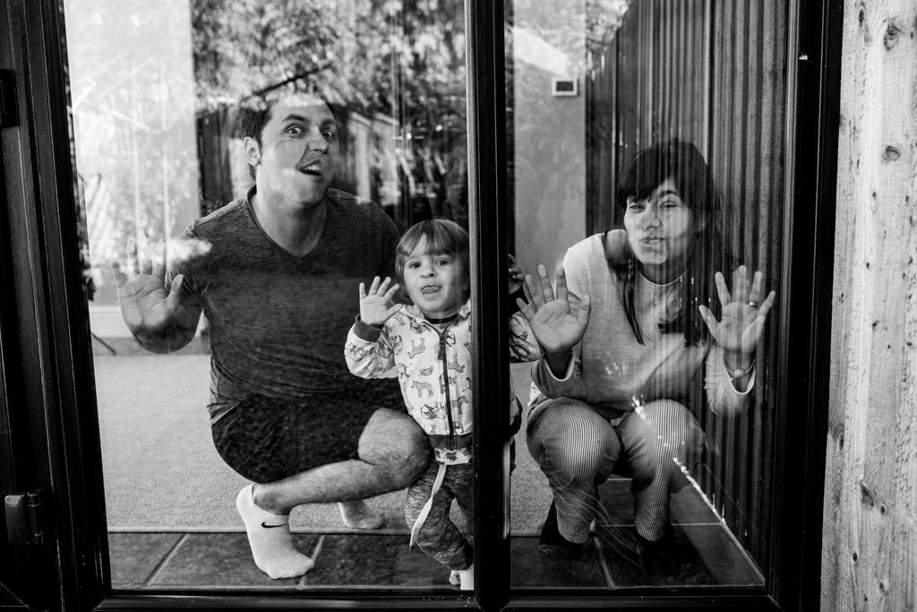 silly family portrait with faces stuck on the conservatory glass