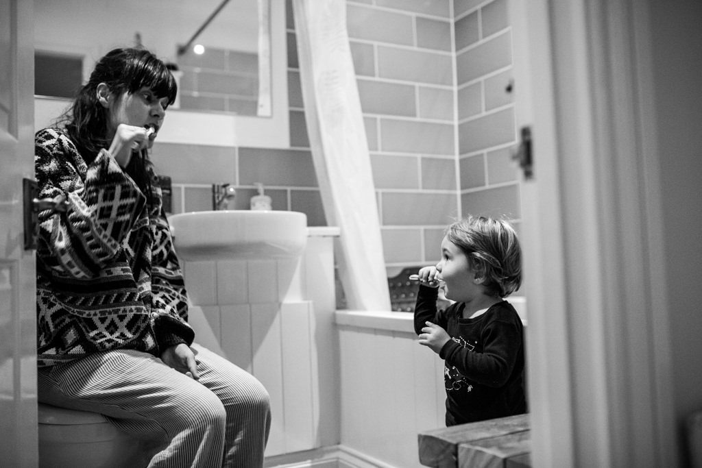 mummy and baby boy brushing up teeth in the morning in the bathroom
