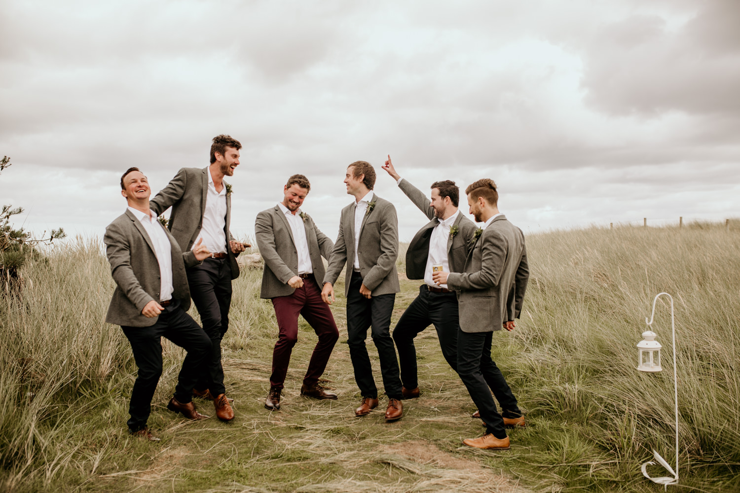groomsmen posing silly before the wedding at Harvest Moon Holidays Scotland