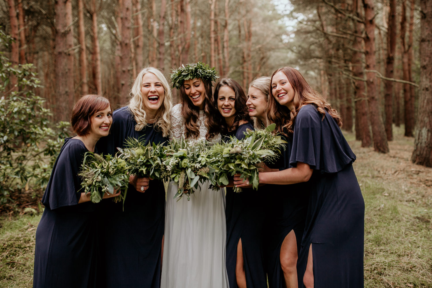 bride and bridesmaids after an outdoor forest ceremony at Harvest Moon Holidays Scotland