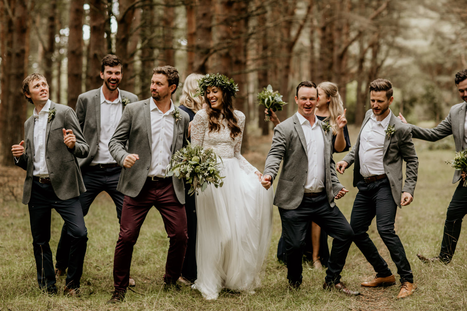 bride and groomsmen for a fun portrait shoot in the forest in Scotland