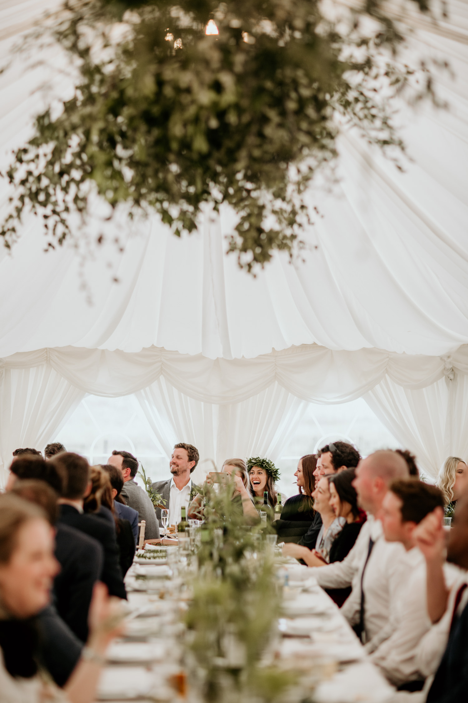 marquee setup and guests sitting at long tables during a Harvest Moon Scotland wedding