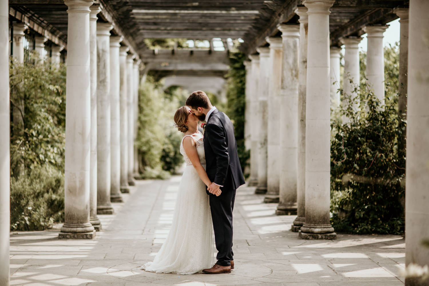 bride and groom kiss after their PErgola gardens Wedding in Hampstead Heath